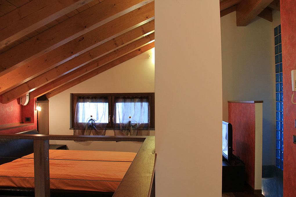 Appartamento con mansarda - Camera da letto open space