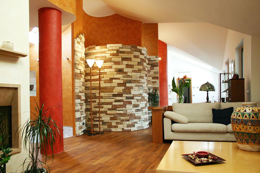 Unione di due appartamenti - Via Cavour Rivestimento curvo in pietra