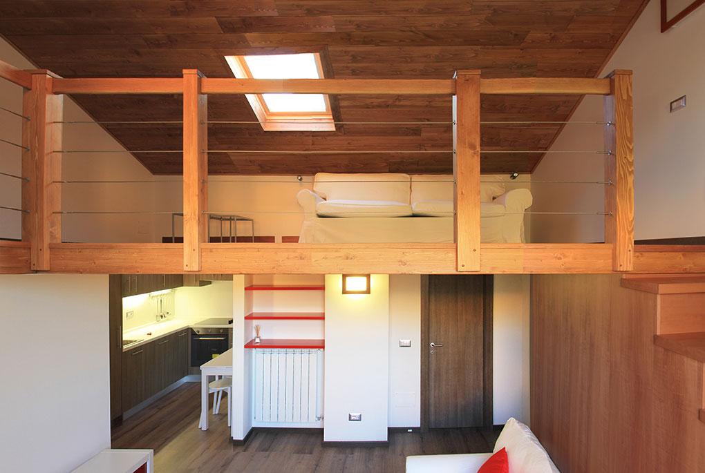 Vivere in soffitta - Via Pellizza da Volpedo Locale soppalcato in legno